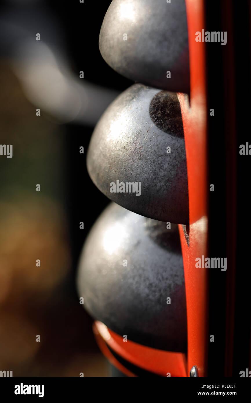 the background of different iron dark hemisphere - Stock Image