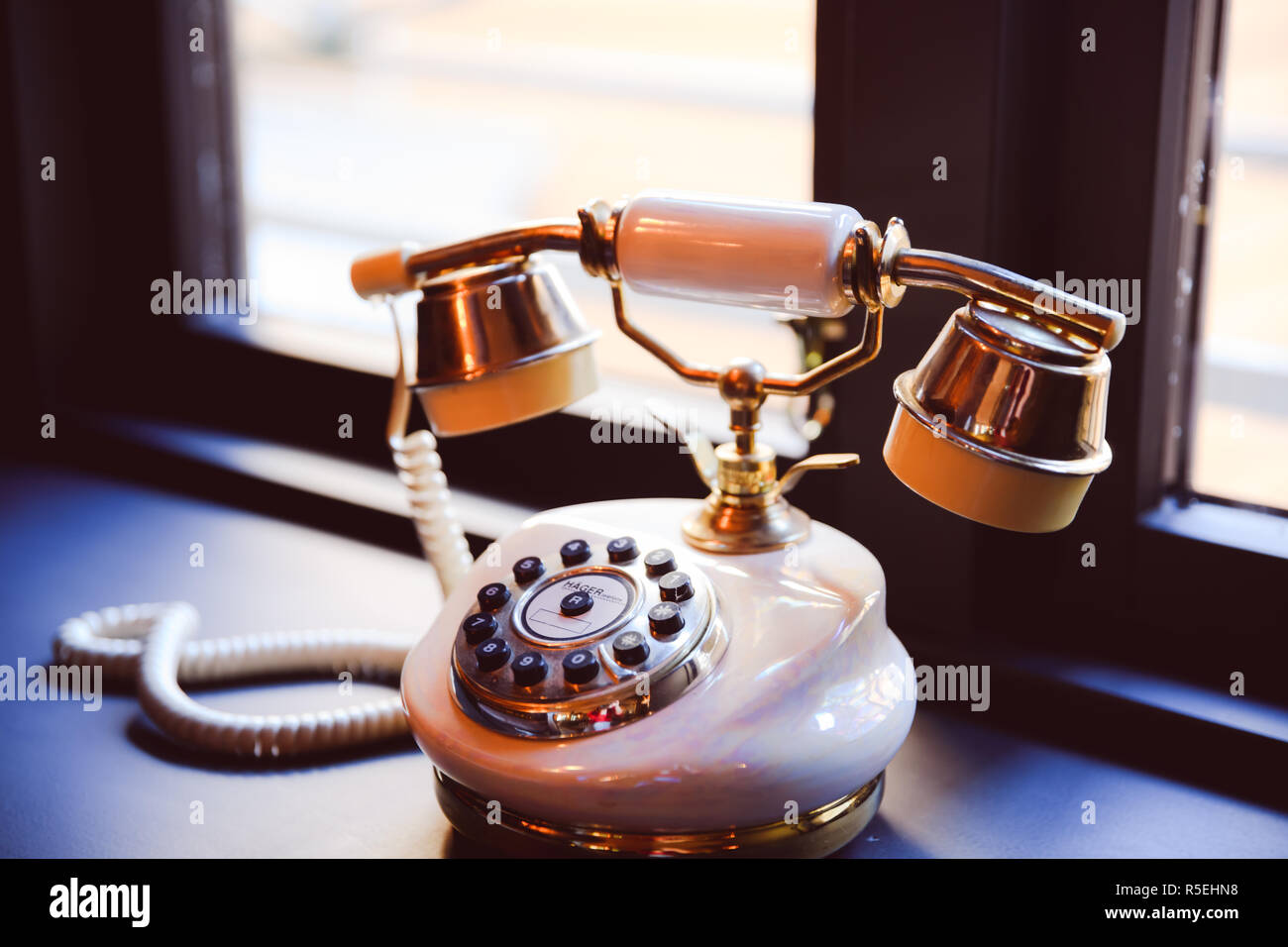 Vintage telephone with pearly facade - Stock Image