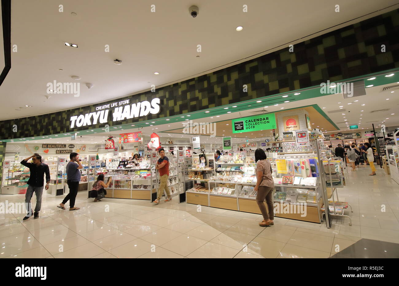 People visit Tokyu Hands department store in Singapore Stock