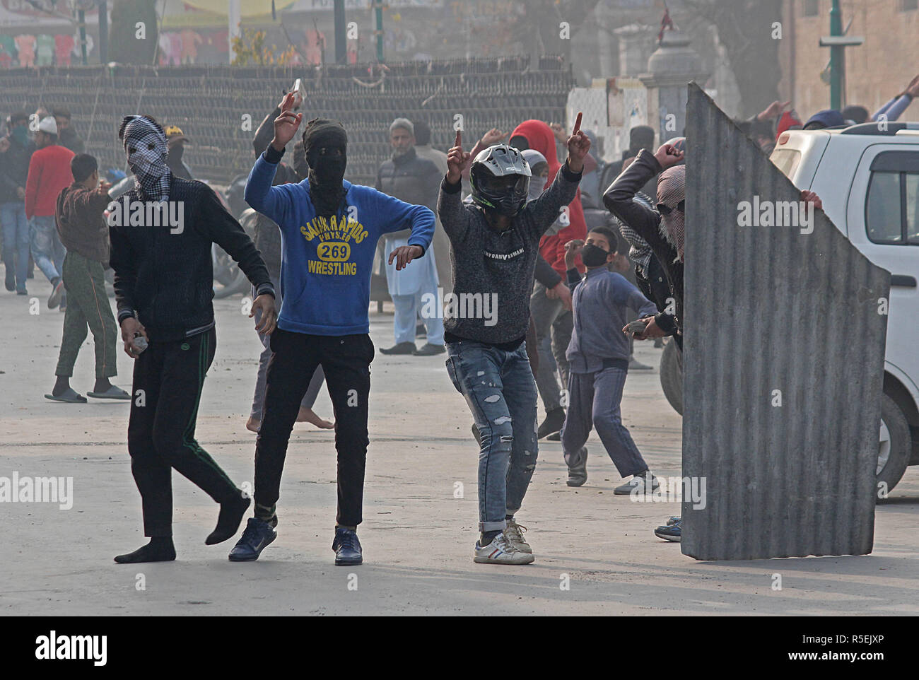 Srinagar, India. 30th Nov, 2018. Kashmiri muslim protestors shout pro freedom slogans in old city Srinagar the summer capital of Indian controlled Kashmir on November 30, 2018.Minor clashes erupt in old part of Srinagar when pro freedom protesters raised slogans and hurled stones on police soon after the Friday congregation prayers ended in grand mosque Nowhatta. Police later swung into action as chased away the protester by firing pellets. Credit: Faisal Khan/Pacific Press/Alamy Live News - Stock Image