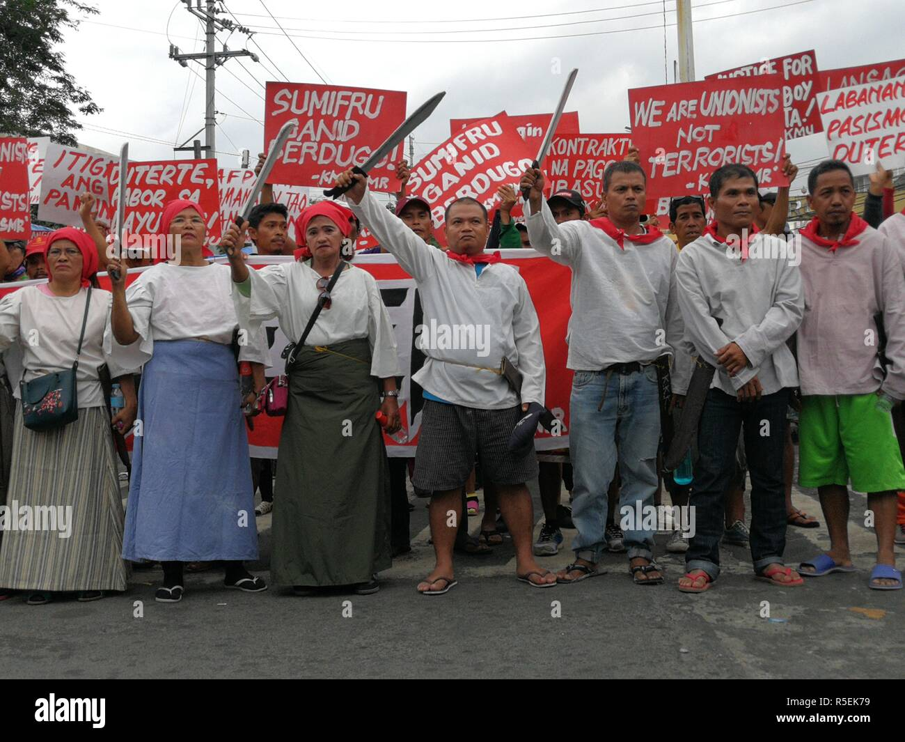 Manila, Philippines. 30th Nov, 2018. Members of various militant groups gathered together to celebrate Bonifacio Day by conducting a protests against Duterte's administration. The protesters brought along with them effigies of President Rodrigo Duterte, Chinese President Xi Jinping and US President Donald Trump in which they burn during the culmination of their rally. Credit: Sherbien Dacalanio/Pacific Press/Alamy Live News - Stock Image