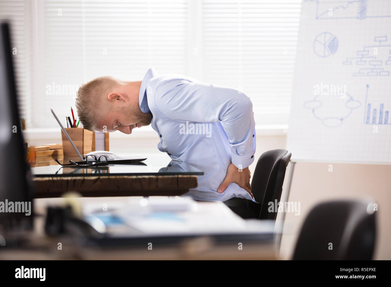Businessman Having Back Pain - Stock Image