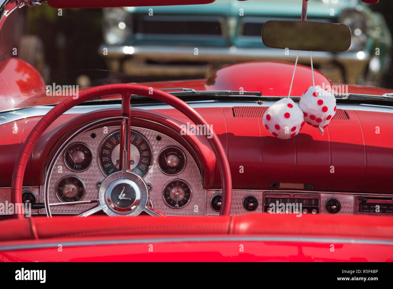 USA, Massachusetts, Cape Ann, Gloucester, antique car show, fuzzy dice in 1950's-era convertible - Stock Image