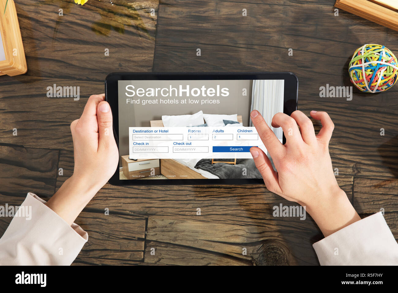 Person Searching Online Low Prices Hotels - Stock Image