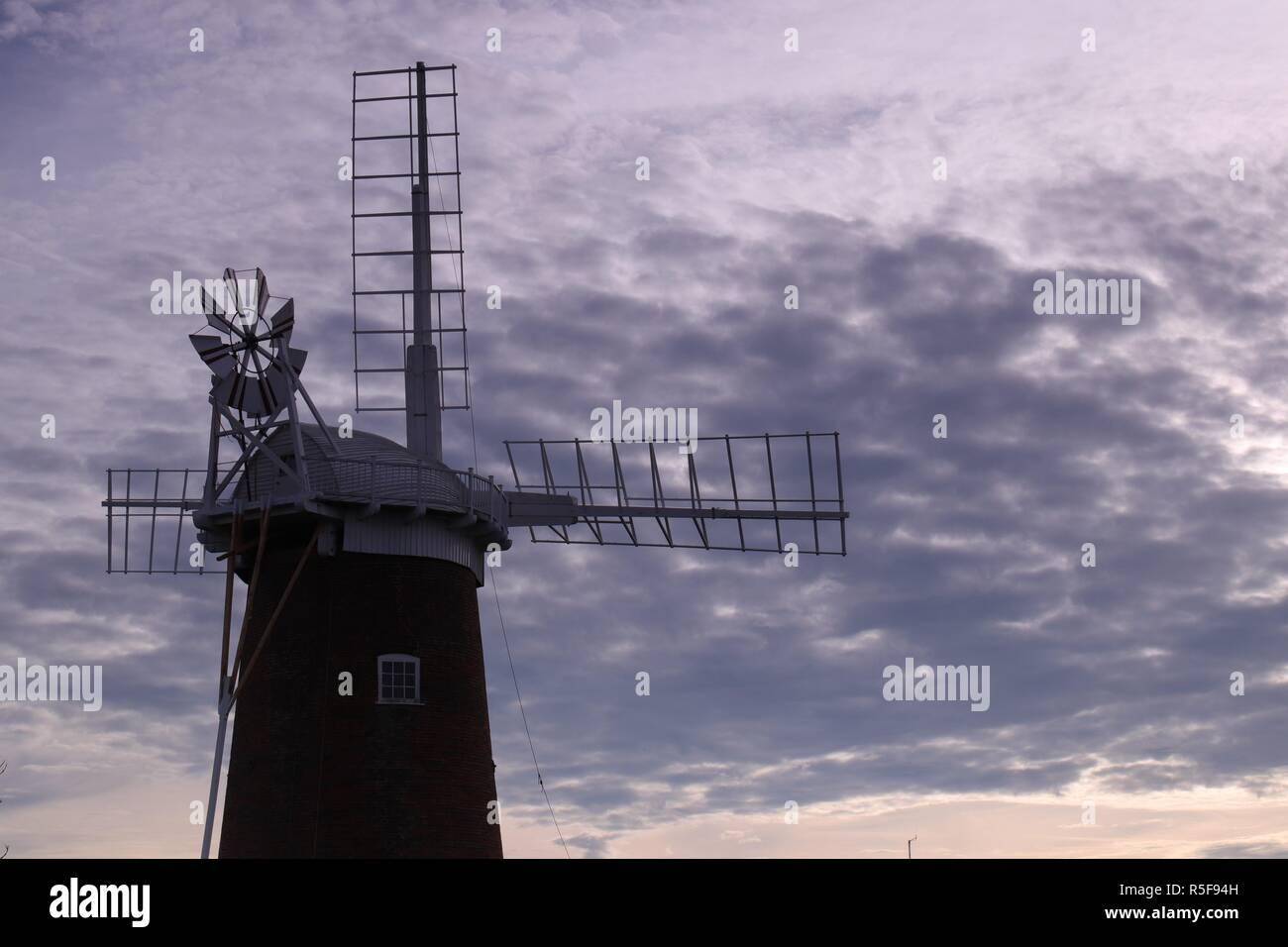 A solitary wind pump on the Norfolk Broads national park in the UK - Stock Image