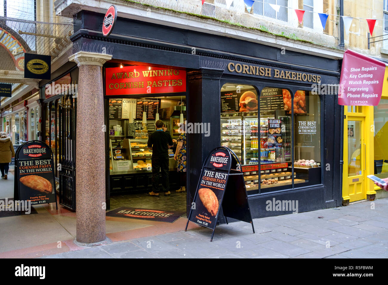 A winters day in Bath city Center, somerset england UK Cornish bakehouse, pasty shop - Stock Image
