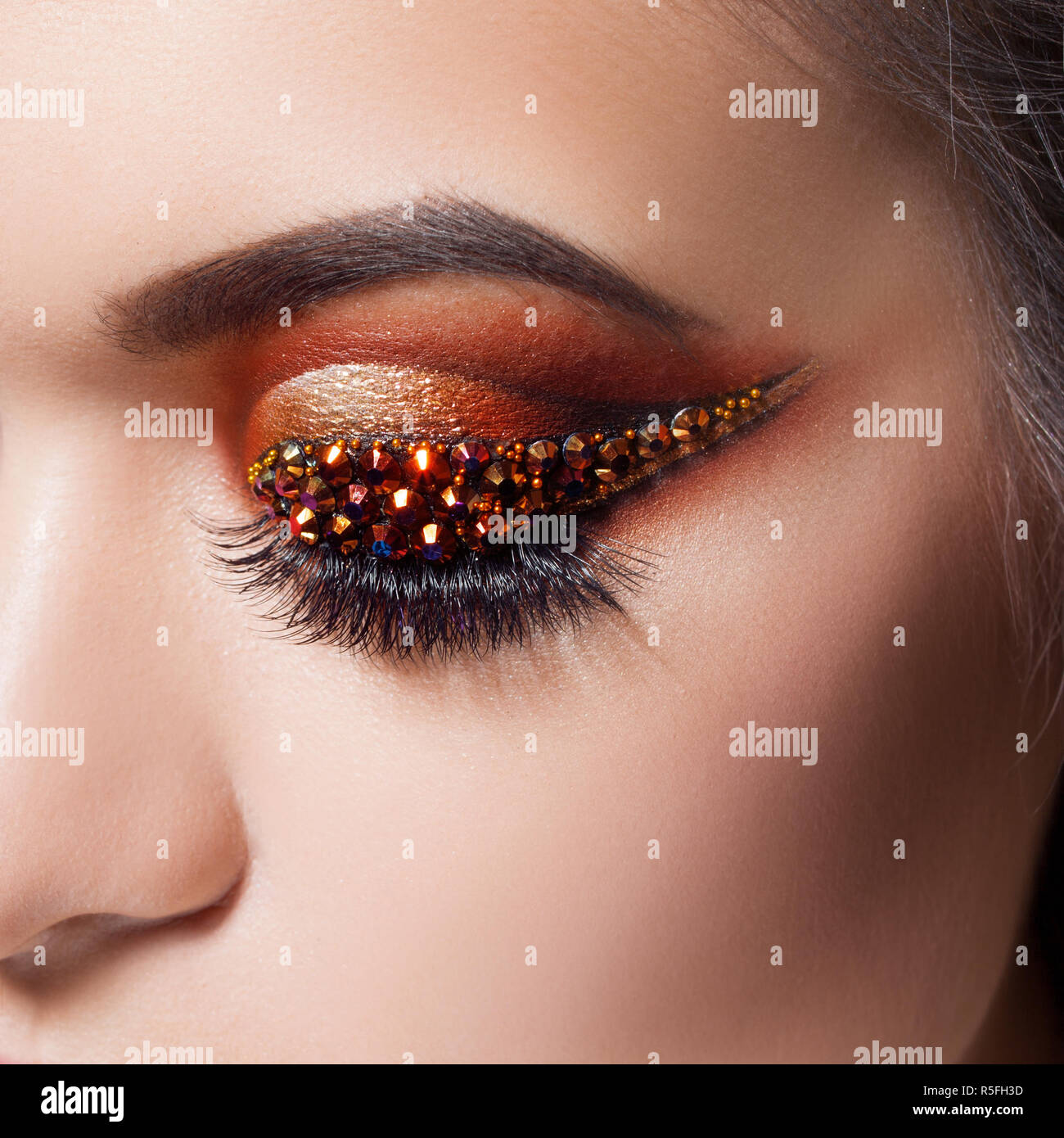 Amazing Bright Eye Makeup With A Arrow With Rhinestones Brown And