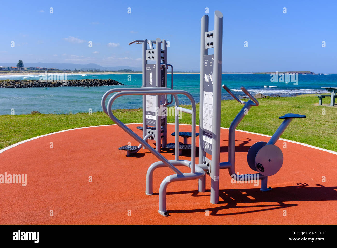 Fighting obesity, outside public exercise equipment, near beach by the local council to encourage people to stay healthy, lose weight and keep fit - Stock Image