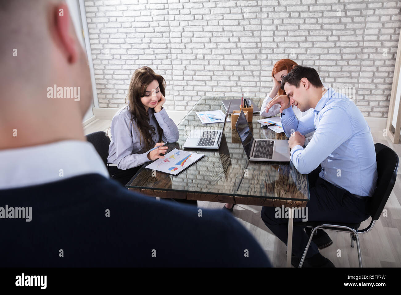 Boredom Coworkers In Office Meeting - Stock Image