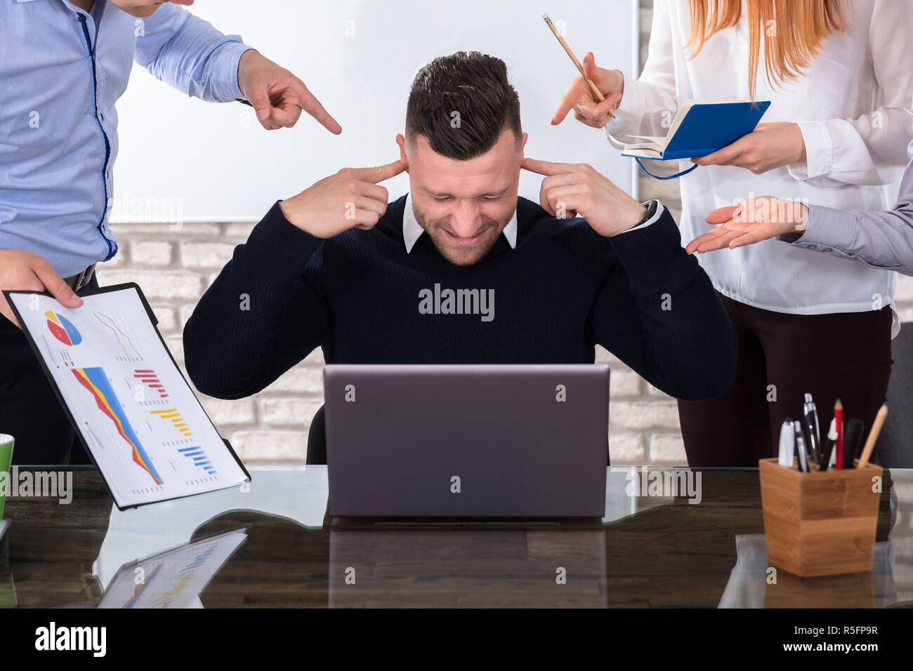 Angry Business People Pointing At Colleague - Stock Image