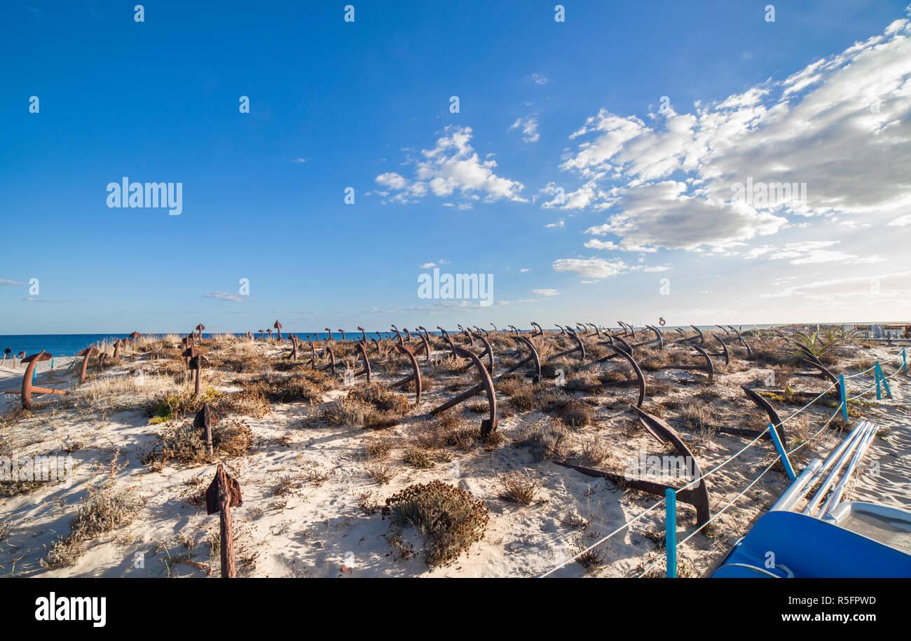Cemetery of Anchors. Memorial monument to dead fishermen of tuna industry in Portugal. Barril beach, Santa Luzia, Algarve Stock Photo