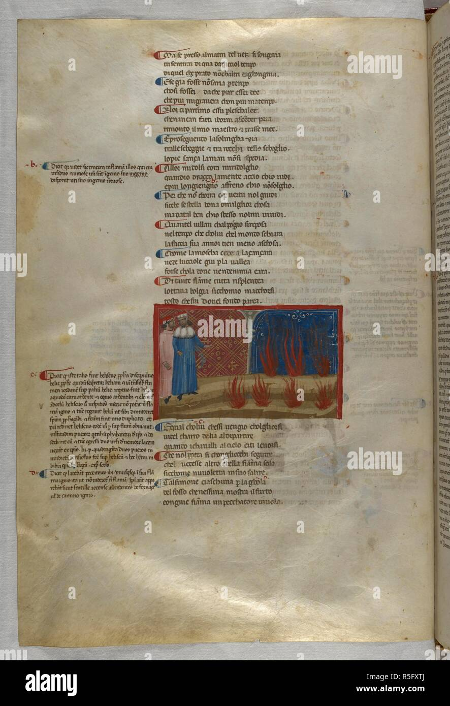 Inferno: Dante and Virgil before the flames of the false counsellor. Dante Alighieri, Divina Commedia ( The Divine Comedy ), with a commentary in Latin. 1st half of the 14th century. Source: Egerton 943, f.46v. Language: Italian, Latin. - Stock Image
