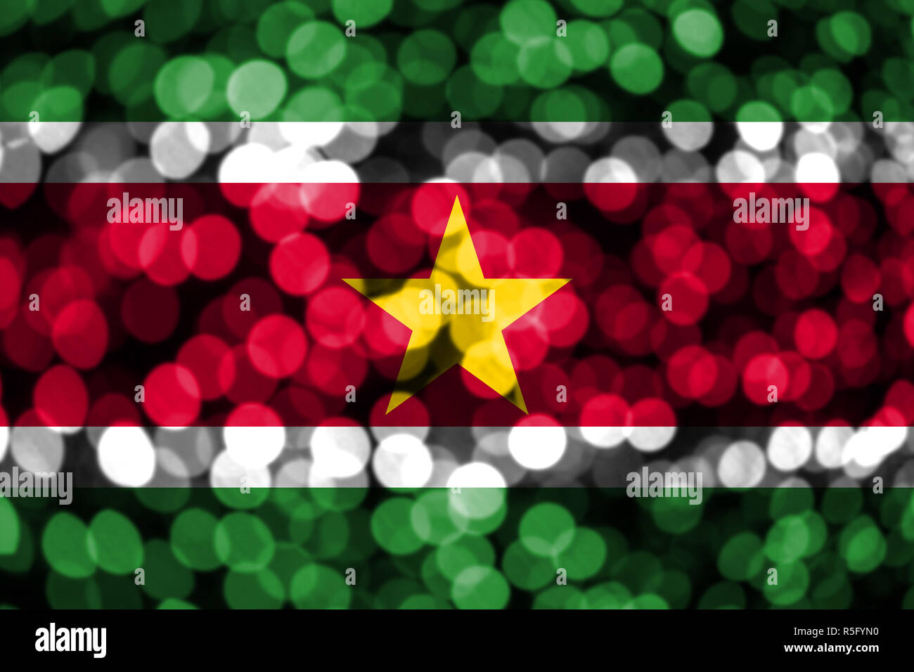 Suriname abstract blurry bokeh flag. Christmas, New Year and National day concept flag. - Stock Image