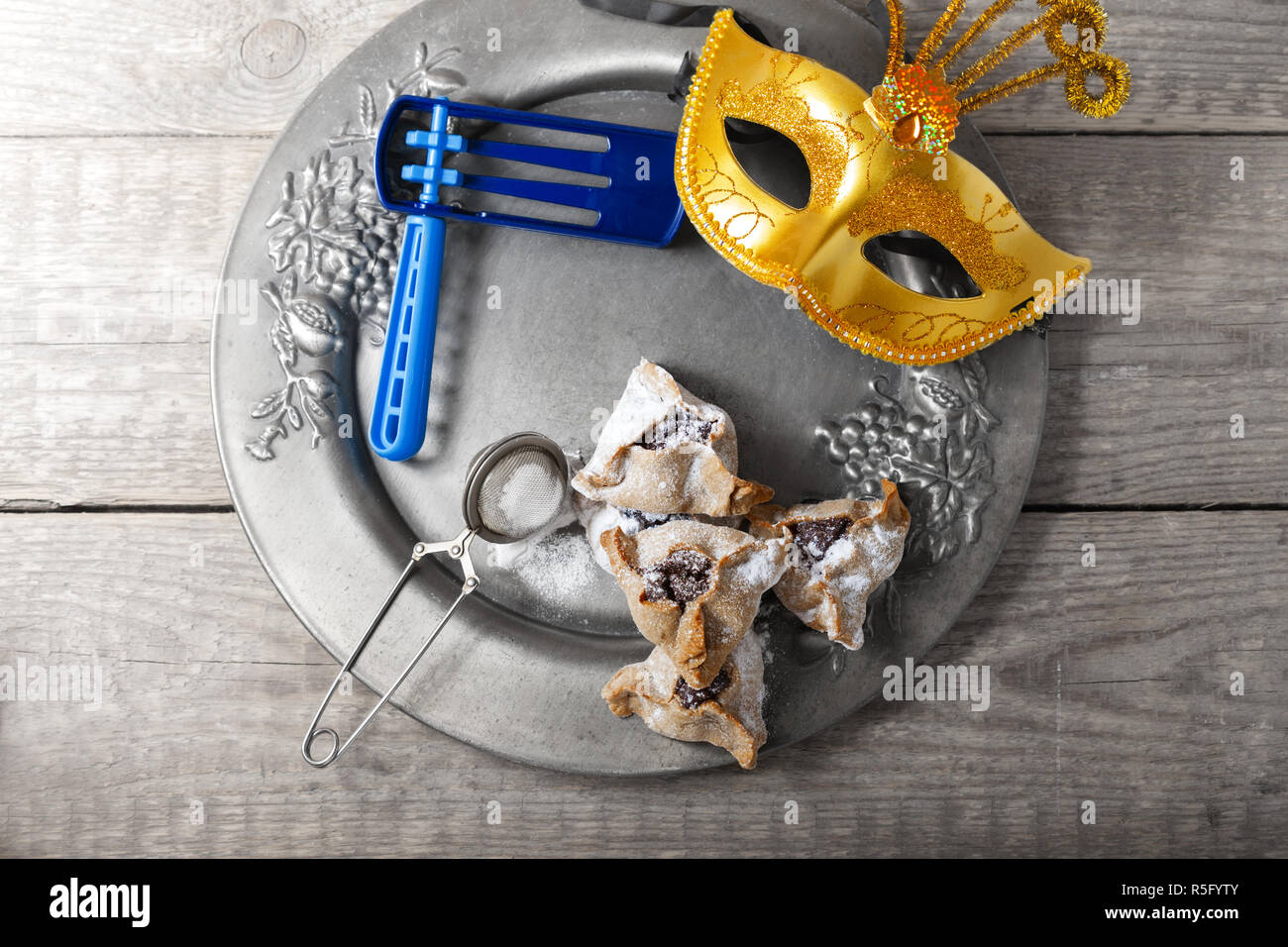 Jewish Pastry Hamantaschen with a mask - Stock Image