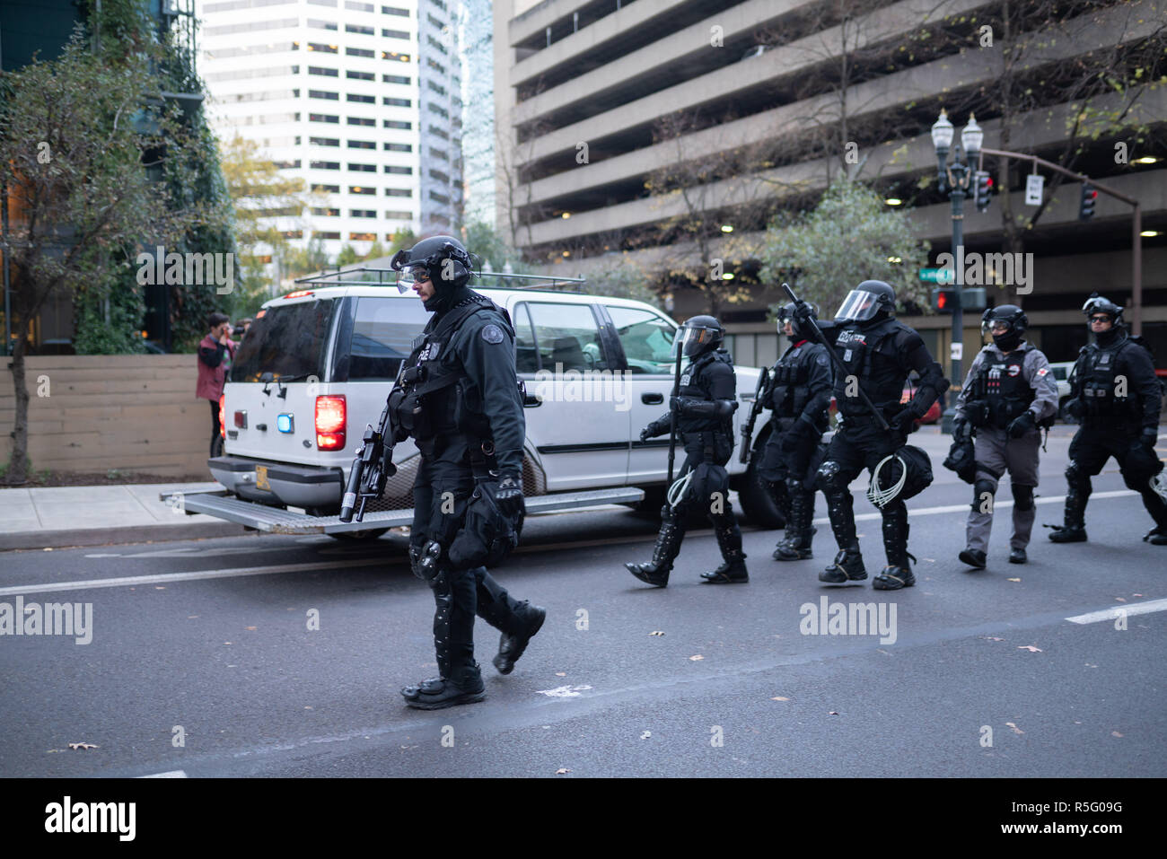 Portland, OR / USA - November 17 2018: Police in heavy riot gear during protest turned into civil disobedience. - Stock Image