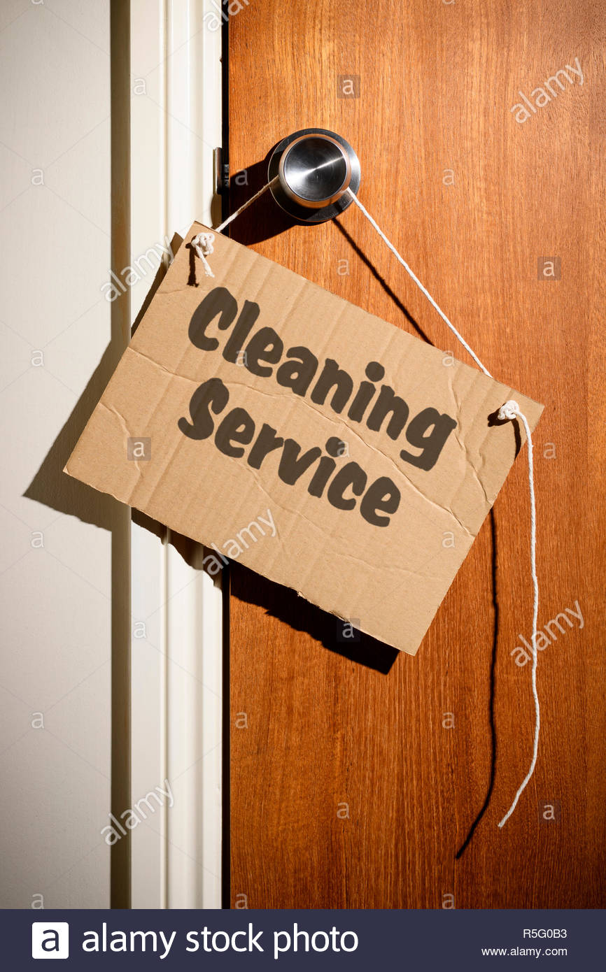 Cleaning Service written on a makeshift sign hanging on the door handle, Dorset, England - Stock Image