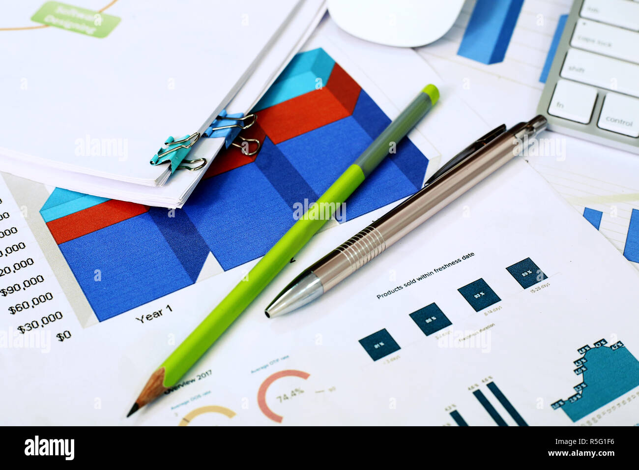 Picture of chart paper, pen and pencil. Stock Photo