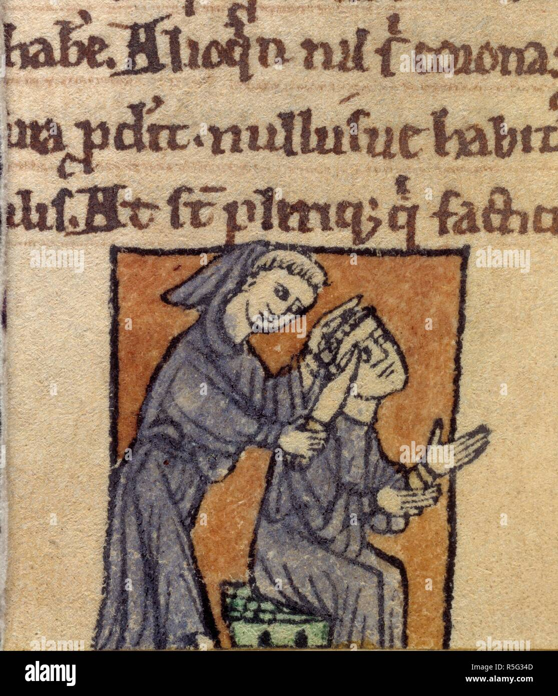 Monk being given tonsure. De similitudinibus. (Detail) A monk being given a tonsure by another monk with a knife.  Image taken from De similitudinibus. . Source: Cotton Cleopatra C. XI, f.27v. Language: Latin. Stock Photo