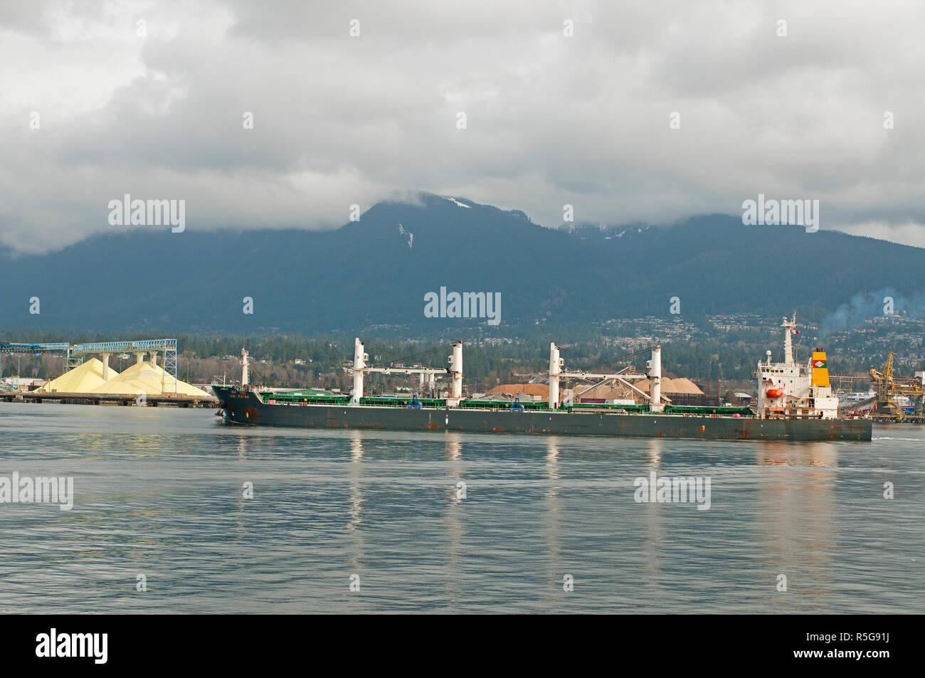The Bulk Carrier vessel in the process of departing from Vancouver in British Columbia. Stock Photo