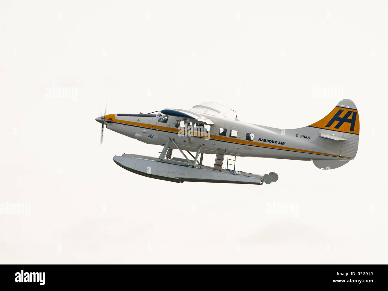A De Havilland Canada DHC-3T Vazar Turbine Otter C-FHAA  departing the waterways  in Vancouver city harbour in British Columbia Canada. Stock Photo