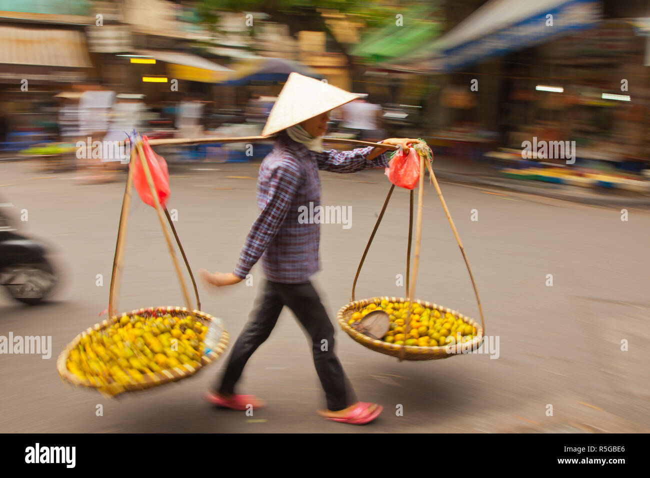 Woman street vendor, Old Quarter, Hanoi, Vietnam - Stock Image