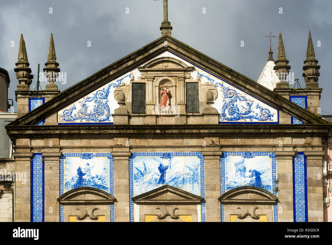 facade and pediment of the Church of St Anthony's Congregation in Porto, Portugal - Stock Image