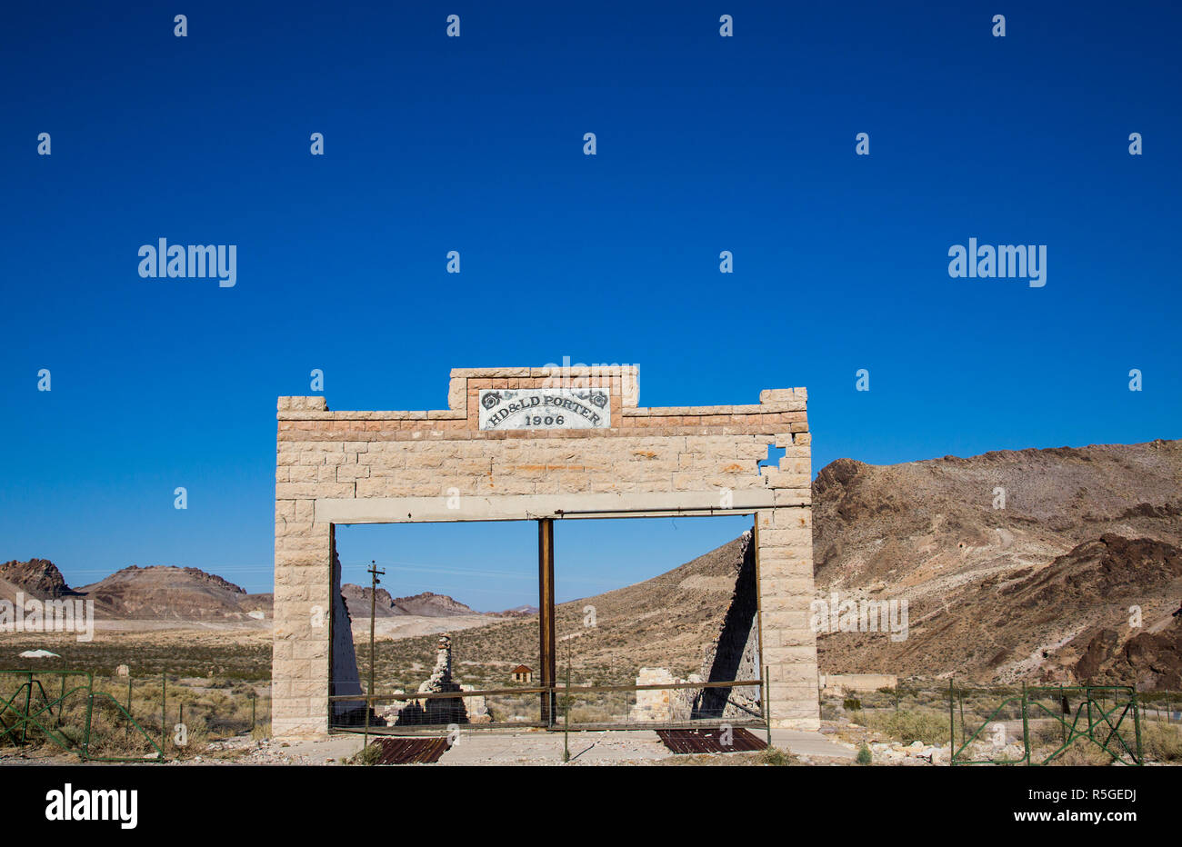Rhyolite is a ghost town in Nye County, in the U.S. state of Nevada. It is in the Bullfrog Hills, about 120 miles northwest of Las Vegas, near the eas - Stock Image