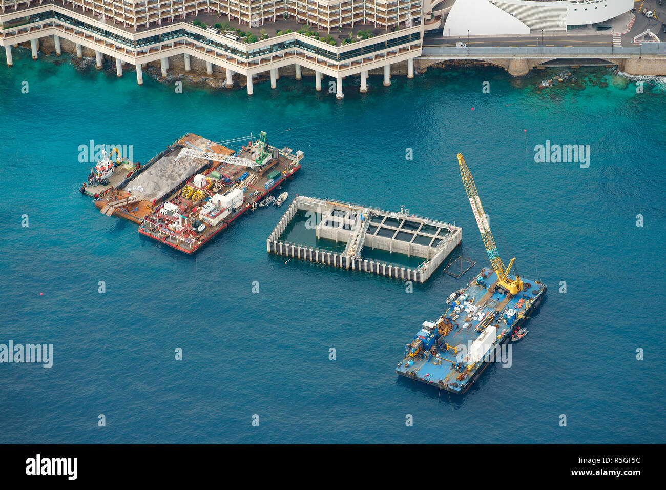 FLOATING CONCRETE CAISSON TO BE USED FOR A LARGE PROJECT OF LAND EXTENSION (aerial view). Principality of Monaco. - Stock Image
