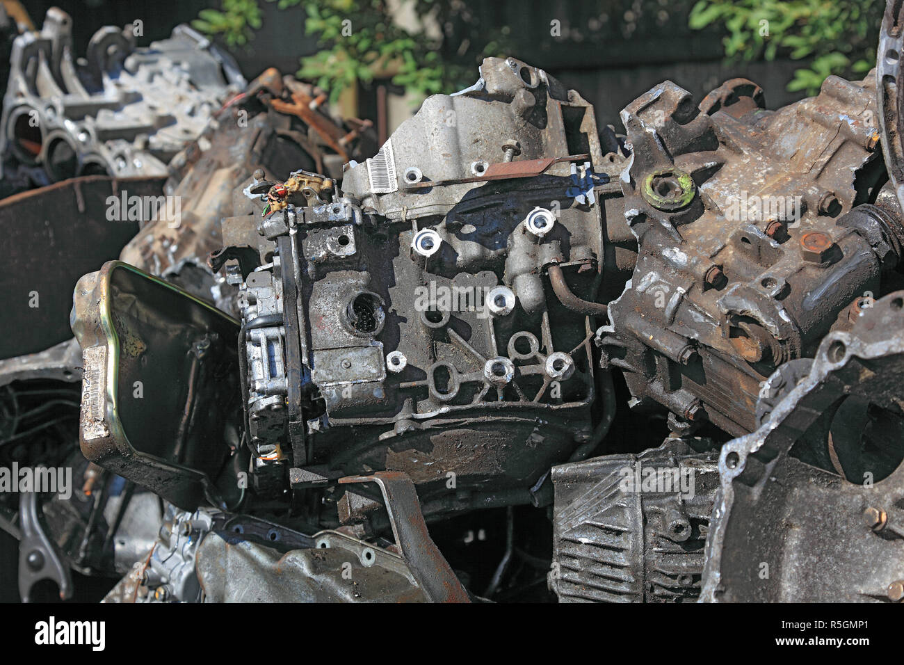 Scrap yard, old car transmission, metal waste in a recycling plant, Germany - Stock Image