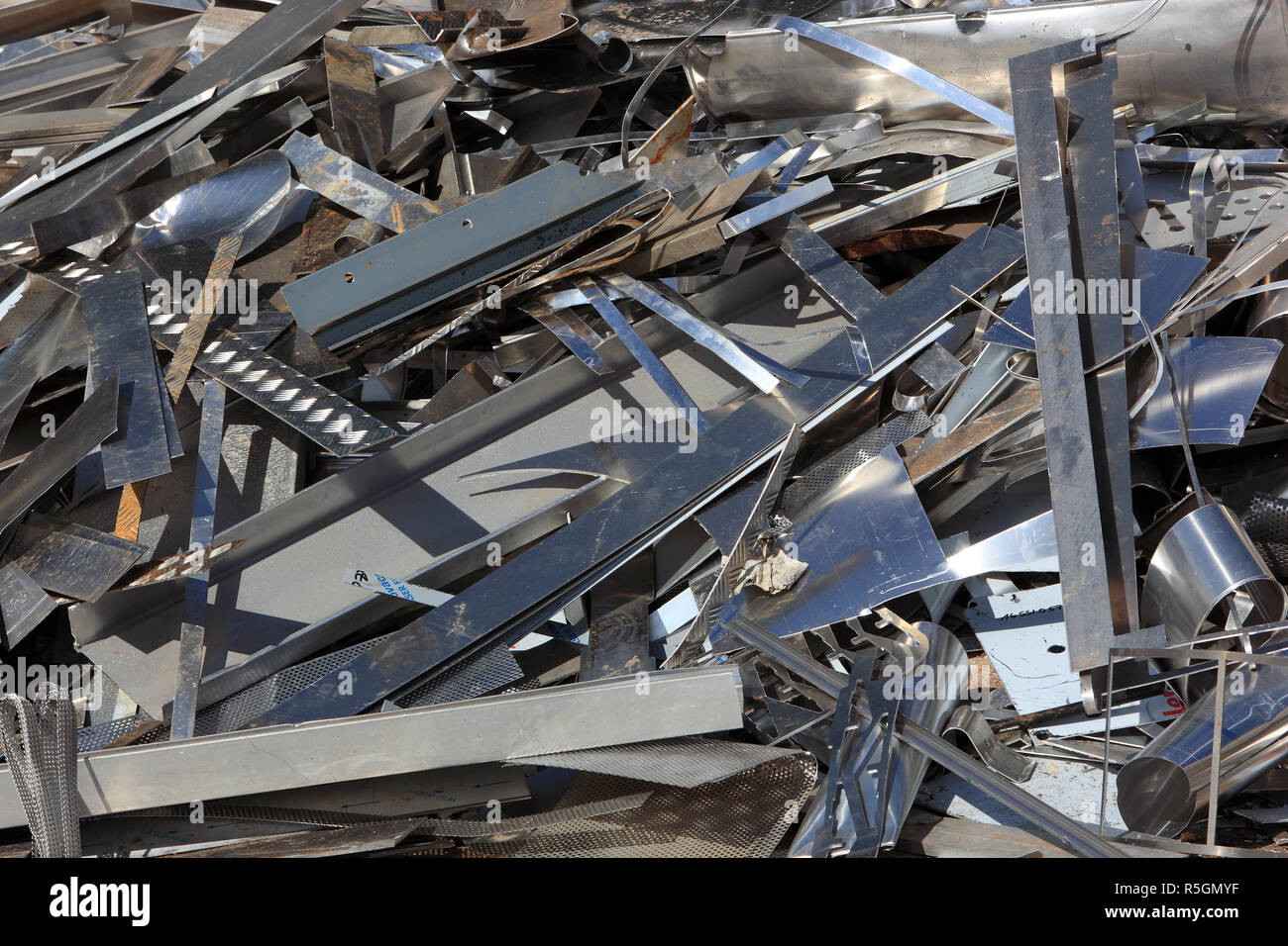 Metal waste of an industrial type on a shotcrete in a recycling plant, Germany - Stock Image