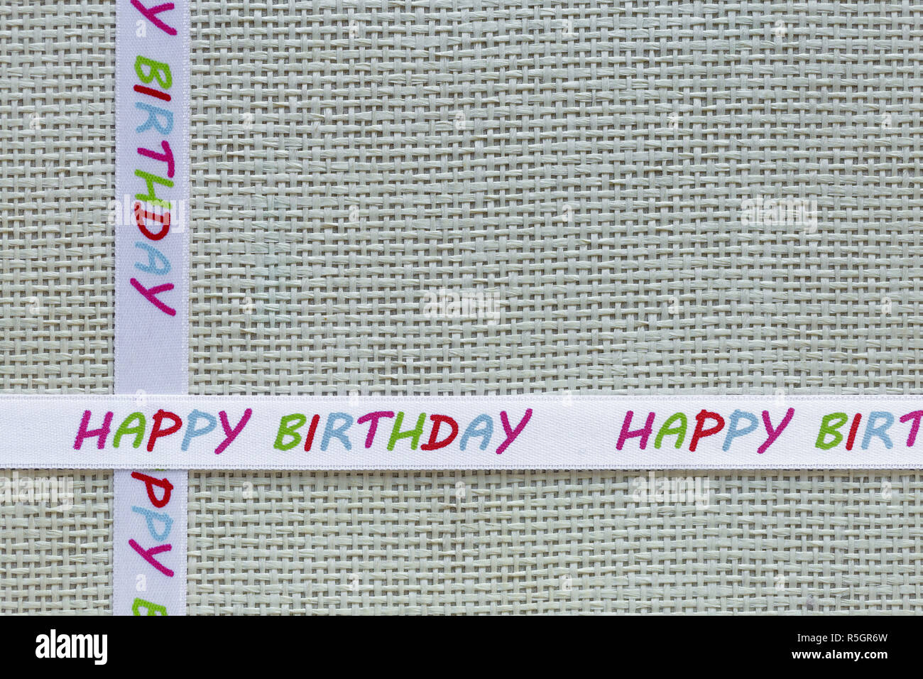 Knitted Box and Decorative Tape With Birthday Message - Stock Image