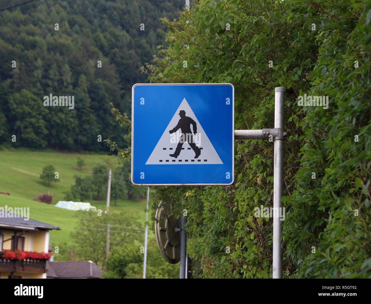 Pedestrian Sign of Man with Hat at Crossover - Stock Image