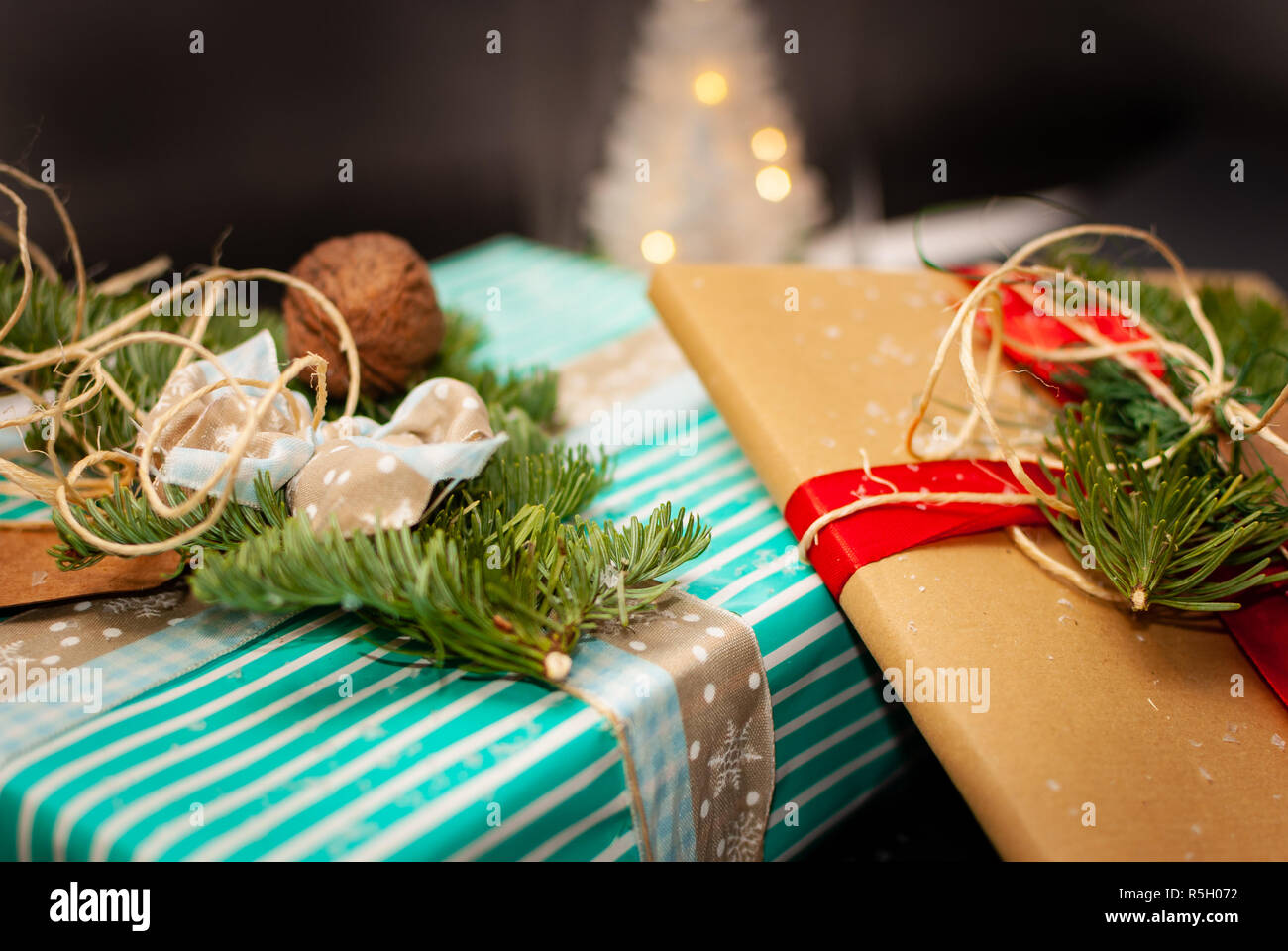Small Christmas Gifts.Colorful And Decorated Christmas Gifts On Black Background