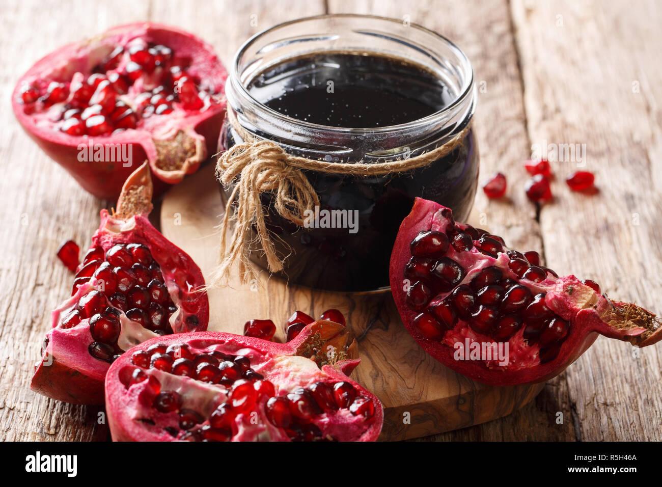 Azerbaijani narsharab seasoning obtained by thickening pomegranate juice close-up on the table. horizontal - Stock Image