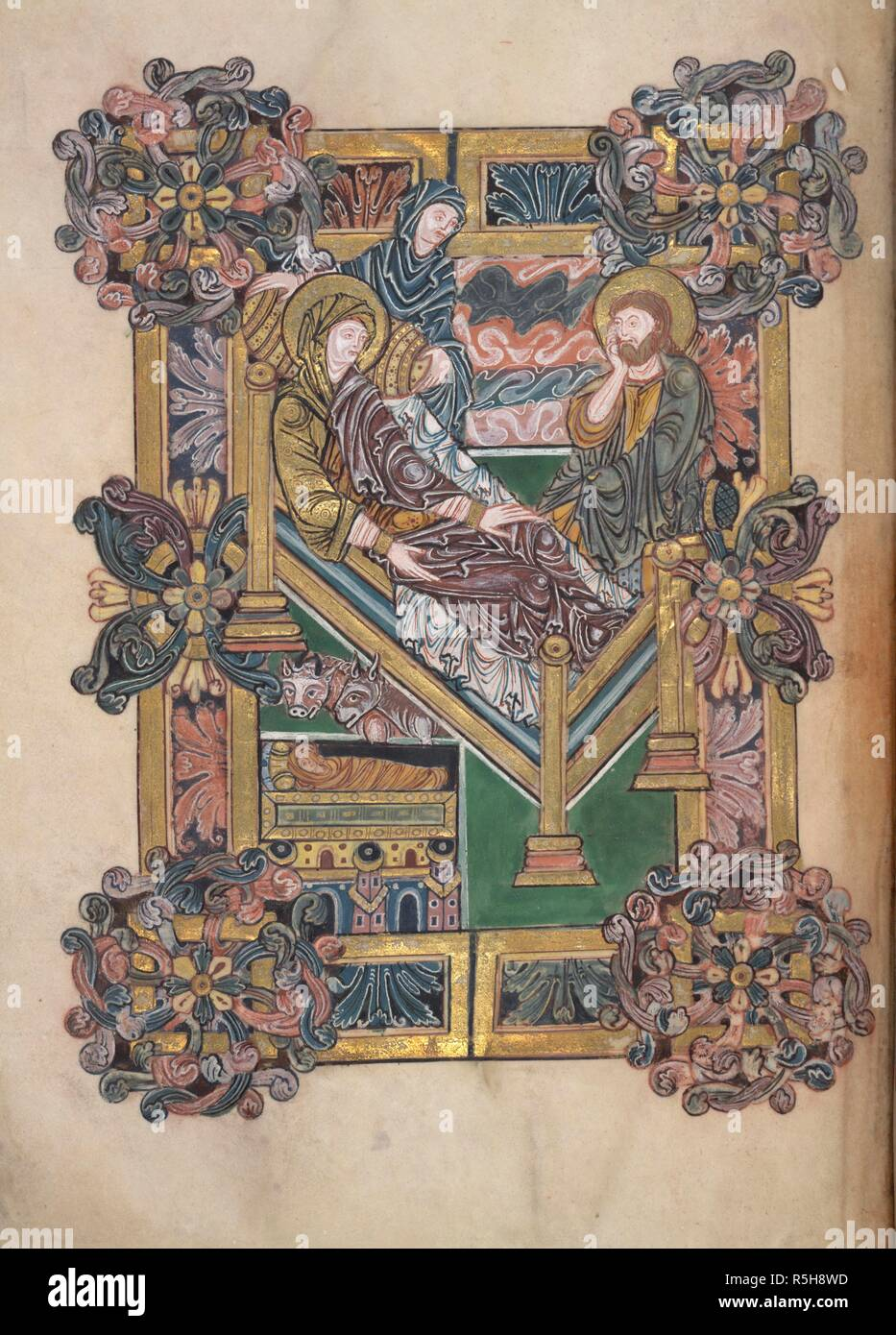 The Nativity. Benedictional of St. Aethelwold. Winchester; 971-984. (Whole folio) Preface to the first blessing for Christmas Day; the Nativity. The Virgin is reclining on a tilted bed, with Joseph seated at the foot. Unusual details include the crib, which is shown on the nearside of the bed, the pillow under Christ's head, and the midwife arranging the cushion under the Virgin's head.The scene is surrounded by a frame of 'Winchester' acanthus, with round bosses at the corners  Image taken from Benedictional of St. Aethelwold.  Originally published/produced in Winchester; 971-984. . Source: A - Stock Image