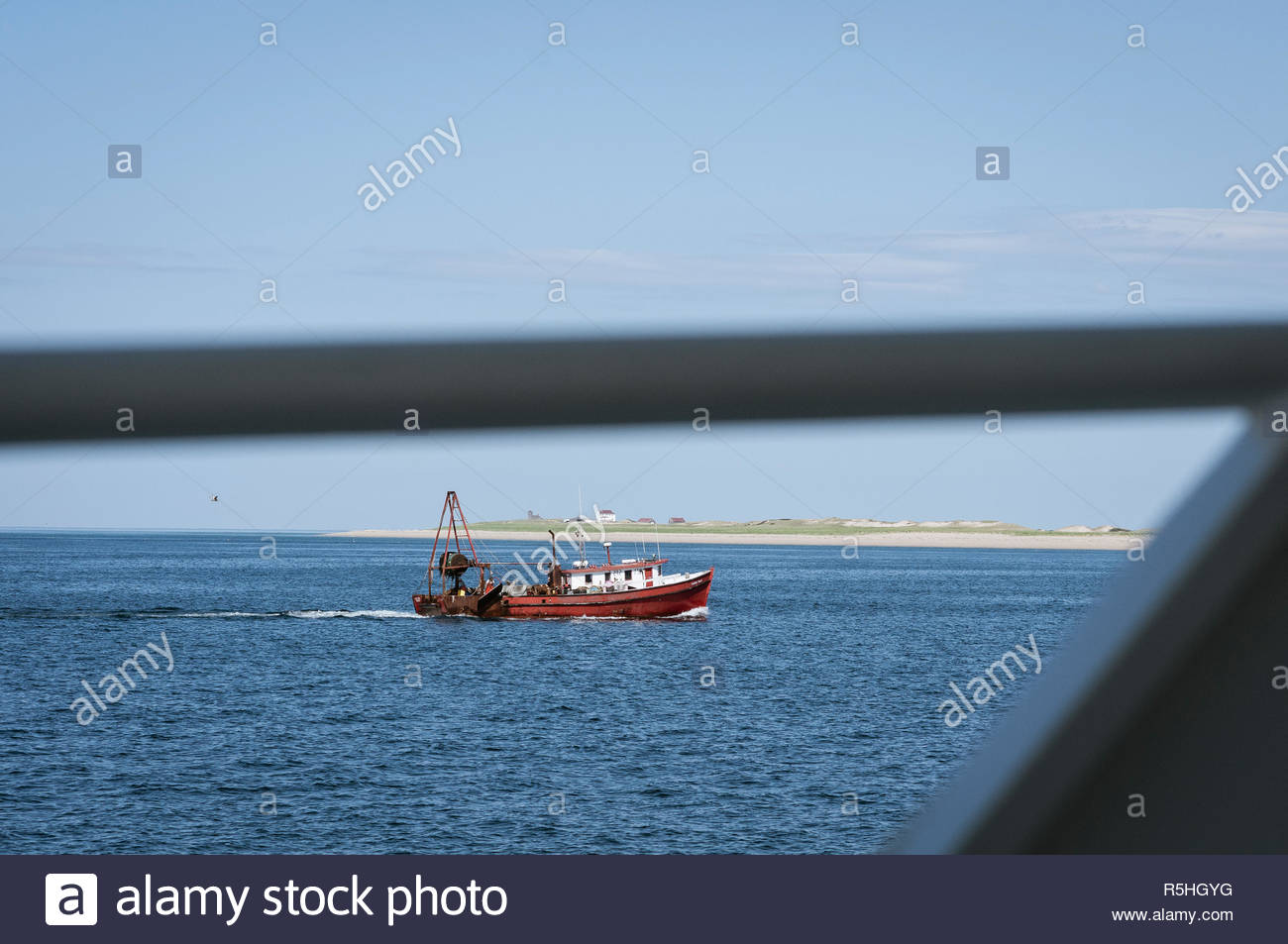 Provincetown, Massachusetts, USA - June 2, 2008: Fishing boat Ancora Praia off Provinctown framed by railing on whalewatch boat - Stock Image