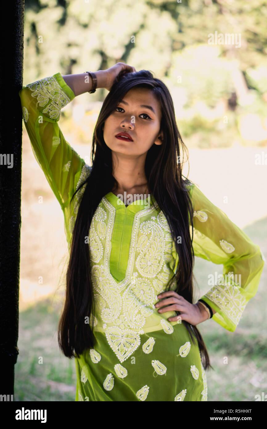 Girl in Chikankari Kurti by Zahba posing for the camera in a park. Stock Photo