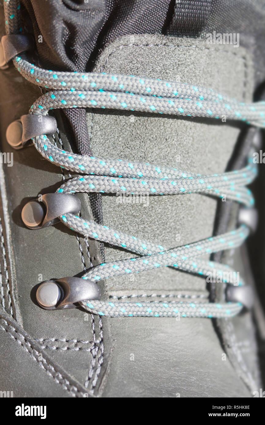 shoelaces on the hiking shoe - Stock Image