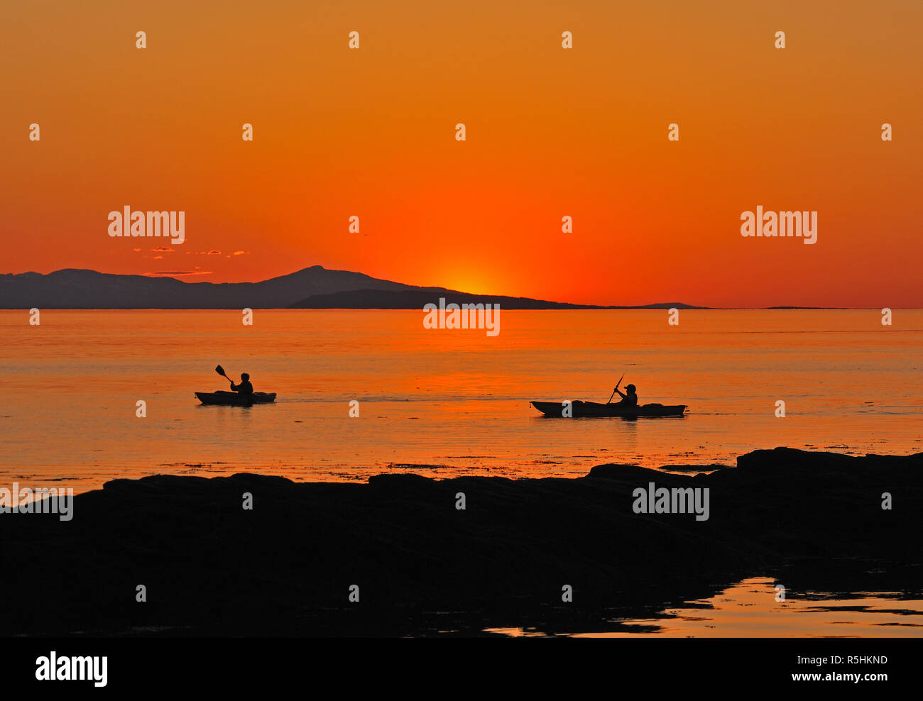 Evening paddle in the last rays of sunlight on Vancouver Island BC Canada. Stock Photo