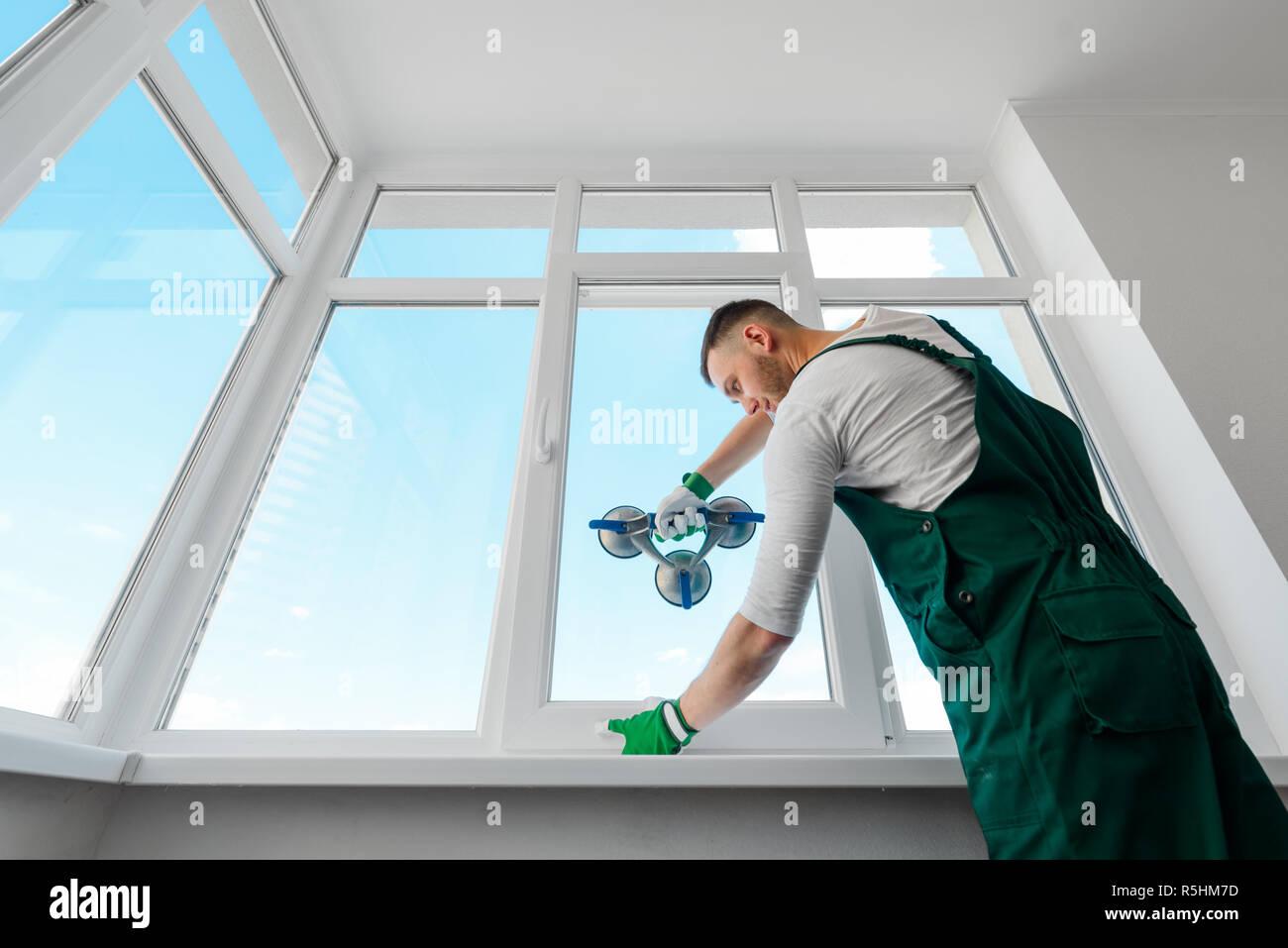 Installing a white corner window - Stock Image