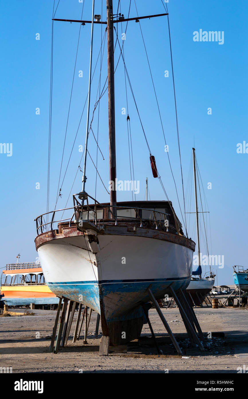 Old vessels in dry dock on a sunny day in Kos island, Greece - Stock Image