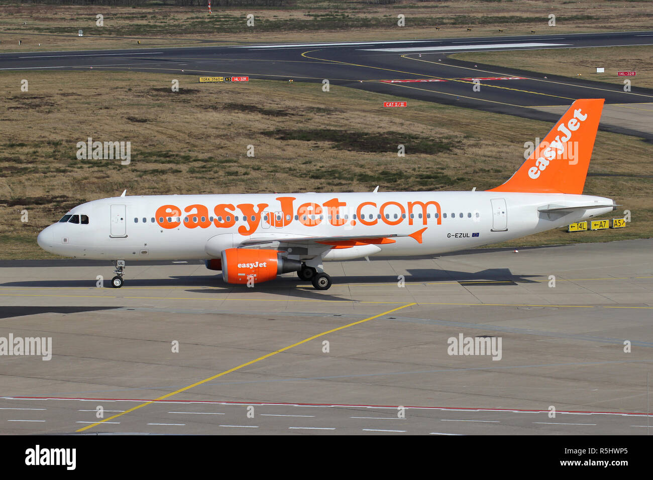 British easyJet Airbus A320-200 with registration G-EZUL taxiing to terminal. - Stock Image