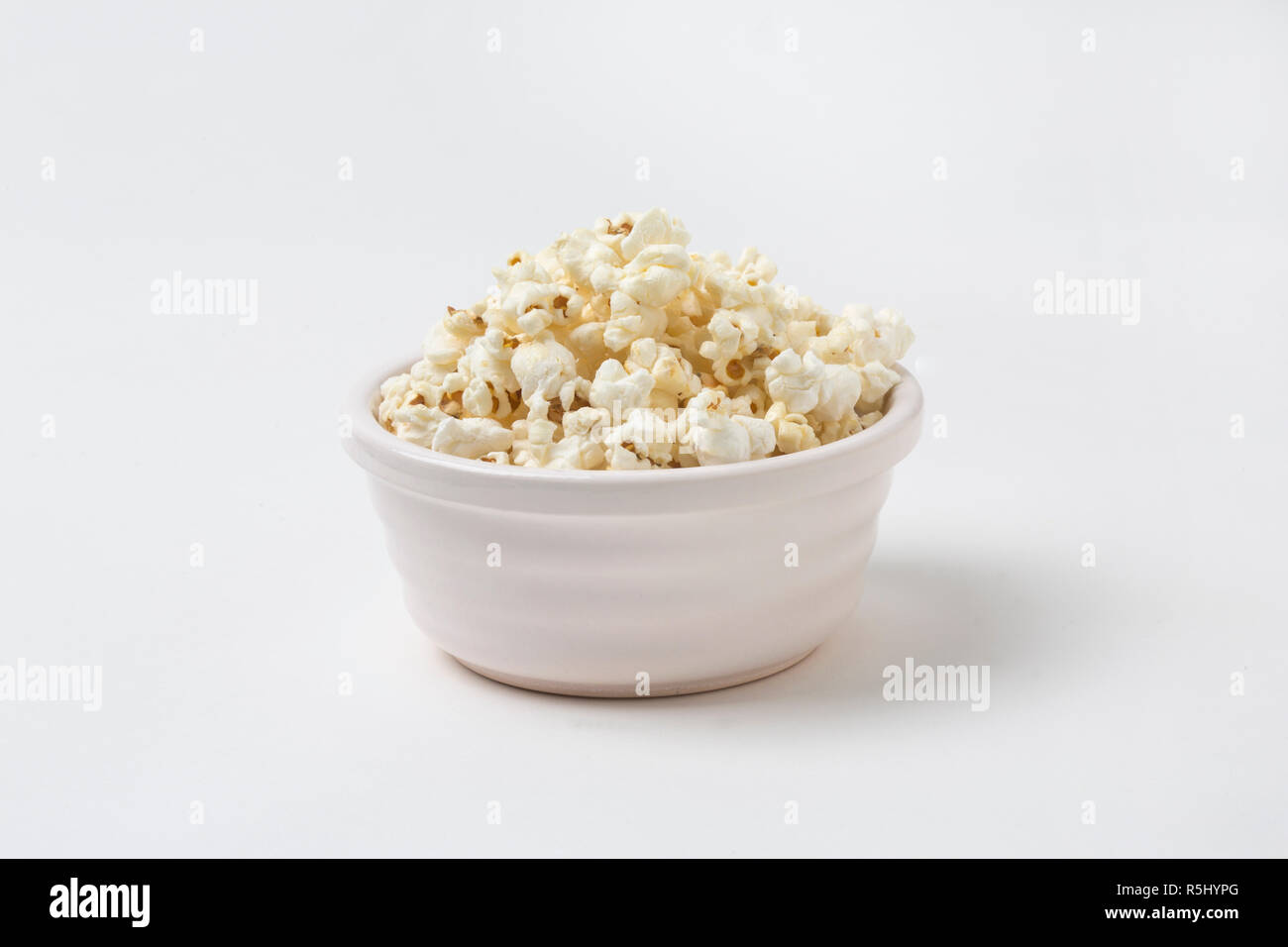 A white bowl of popcorn Stock Photo