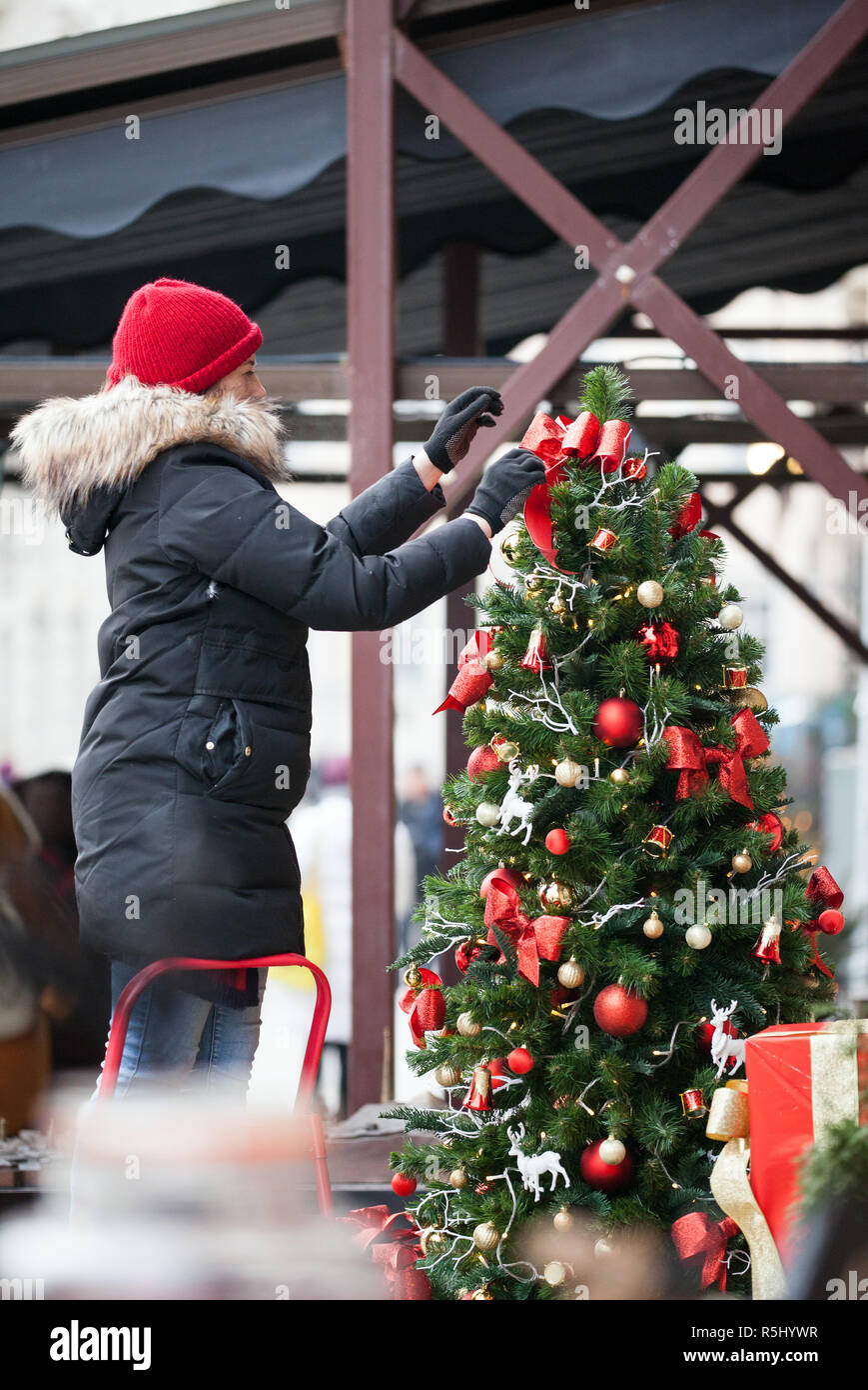 Decorating Christmas Trees Outside.Woman Decorating Christmas Tree Outside Outdoor Christmas