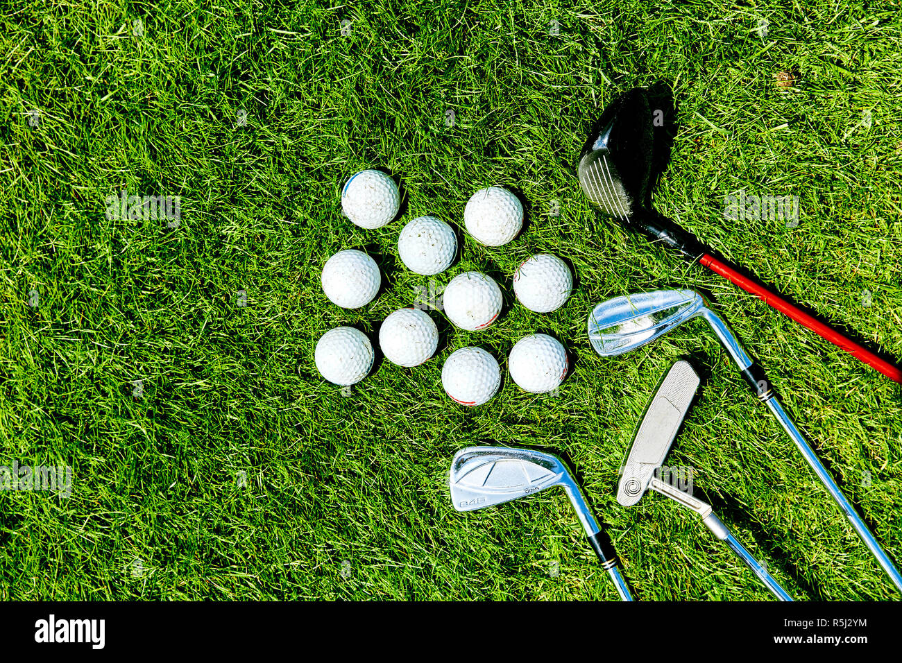 golf clubs and balls on grass background for text Stock Photo