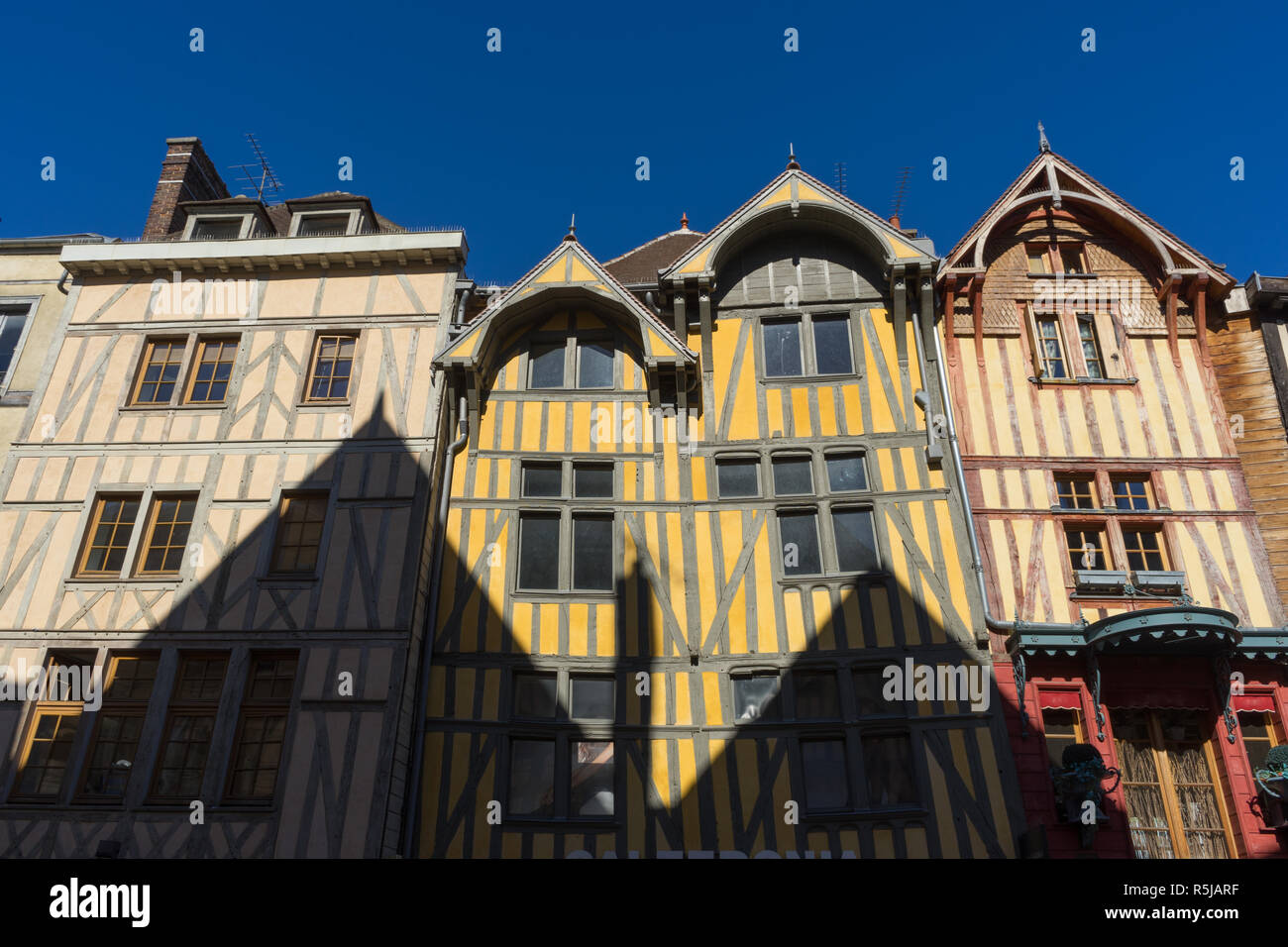 Half timbered lattice construction houses in Troyes France. Troyes is a historical city in France with several half-timbered coloured houses. - Stock Image