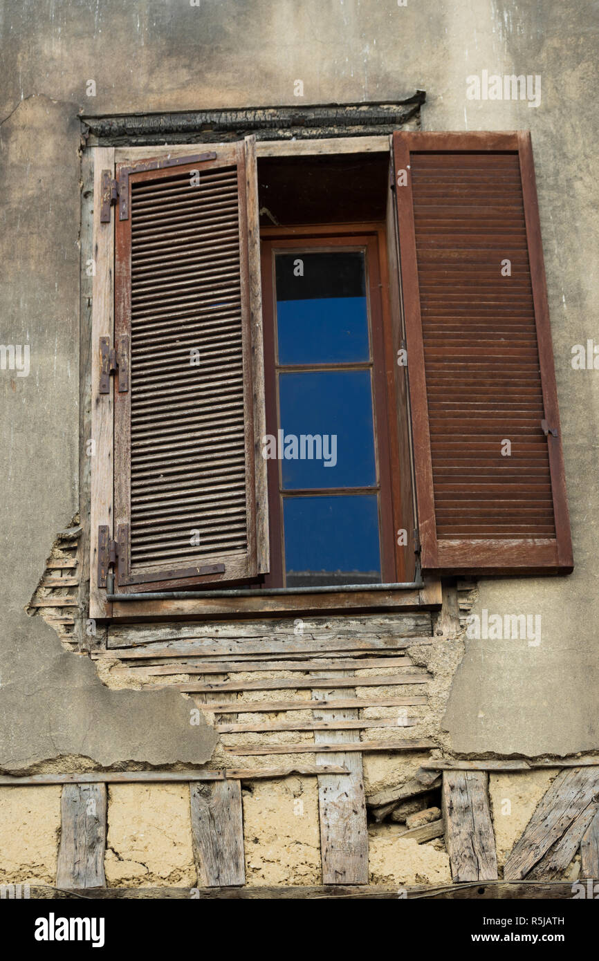 Window in Half timbered lattice construction houses in Troyes France - Stock Image
