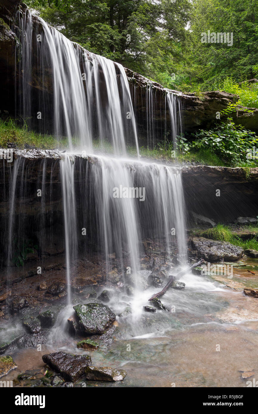 Water splashes over the two-tiered plunge of the waterfall at Oglebay Park in Wheeling, West Virginia. Stock Photo