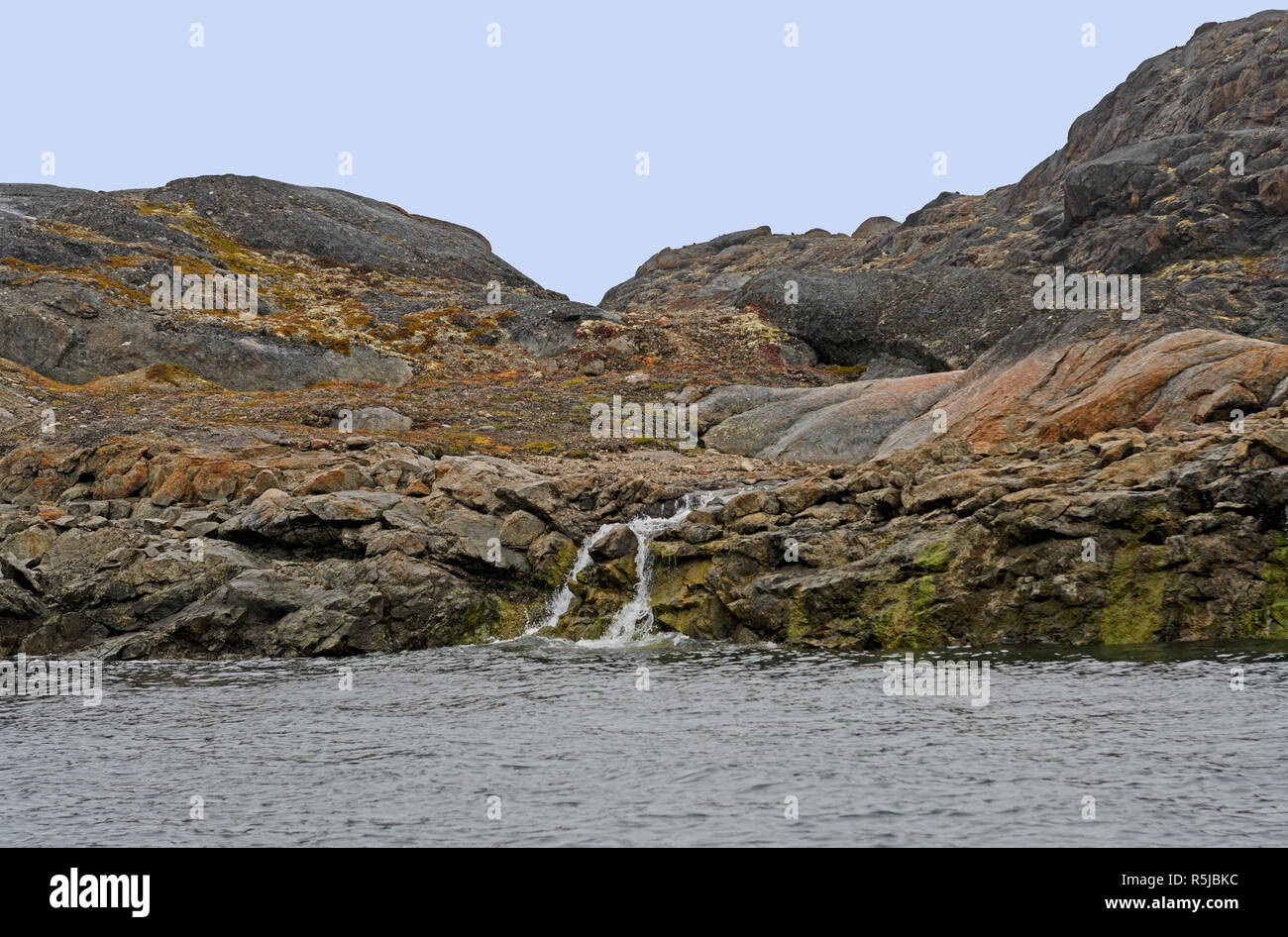 Barren Rock and a Stream in the High Arctic on the Lower Savage Islands on Baffin Island in Nunavut, Canada - Stock Image