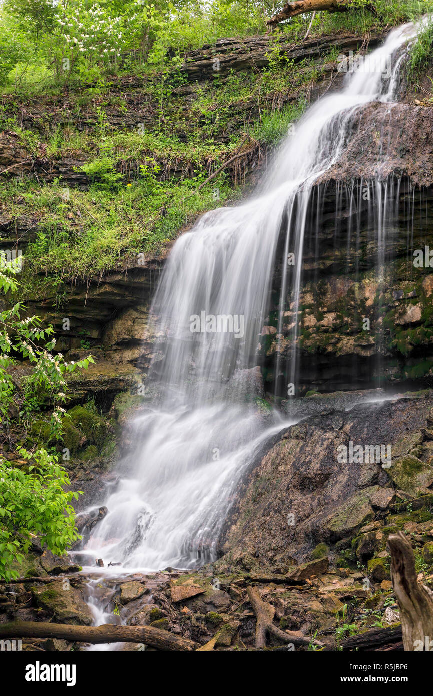 Martindale Falls, a waterfall in Montgomery County, Ohio, tumbles down a rocky cliff after a spring rain. Stock Photo